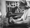 Christie Pratte uses the microscope in the Medical Technology Program, 1965