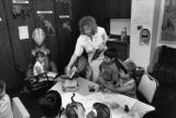 A faculty member sets up a dinosaur-themed activity in the Hartman Education Clinic, circa 1988