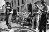 A band plays outside Lalumiere Hall during Spring Thaw, 1988