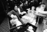 Students prepare and package sandwiches for Midnight Run, 1997