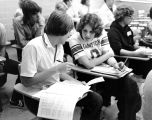 Students discuss course selections during registration period, fall 1976