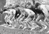 Mike Sucharda, Barry Vail, and other members of the men's cross country team line up at the start...