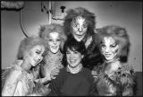 An unidentified faculty member poses with the cast of a performance of Cats
