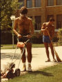 Men edge the lawn near the Schroeder Complex, circa 1985
