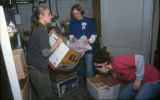 Three female students clean a room during Hunger Clean-Up, 2002