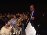 Nicholas Contorno speaks with the French horn section