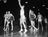 A Marquette player prepares to shoot the ball in a game against Bradley, 1956