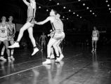 A Creighton player jumps in the air, 1956