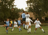The men's soccer team plays a match as part of homecoming activities, 1988