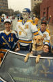 Hockey players participate in the homecoming parade, 1988