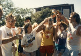 Students squirt shaving cream on each other during orientation, 1988