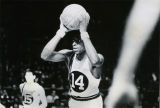 Dean Meminger looks to pass the basketball to a teammate, 1968-1969
