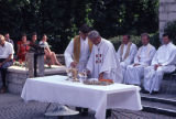 Jesuits prepare altar during outdoor Mass, 1981