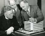 Marquette University President Edward J. O'Donnell, S.J., looks at an architectural model of the...