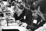 Students wear headphones and prepare notes during the 1972 presidential campaign