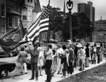 A group gathers on the sidewalk near O'Hara Hall in preparation for the Helfaer Theatre...