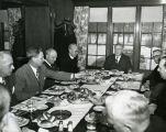 A group of men at a meeting, circa 1945