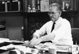 Clifford L. Helbert, Dean of the College of Journalism, works at his desk, 1967-1968