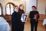 Darlene Weis presents a photograph of Tommy Thompson to Dr. Katino Loria, October 2001