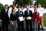 Members of the 2003 men's basketball team attend a picnic with Wisconsin Governor Jim Doyle, 2003.