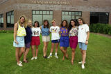 A group of female students in the Freshman Frontier Program pose outside the Alumni Memorial...