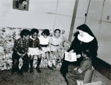 A Blessed Sacrament Sister teaching in a Private Home, Gary, Indiana, Undated