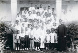 Group Portrait of Children and Pastor at Dedication of St. John Vianny Chapel, Mouton Switch,...