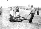 Cowboys roping forelegs of a saddled horse,  n.d.