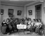 Sister Carmelita Telles, O.S.F., and nine students knitting, n.d.