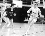 Joan (Pitrof) Flayter dribbles ball down court, 1987 - 1988