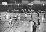 Women's volleyball team dig out ball, 1976