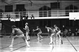 Women's volleyball team prepares for action, 1975
