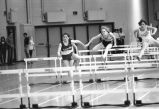 Unidentified athlete runs hurdles, 1984