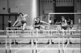 Unidentified athlete jumps hurdle, 1984
