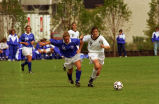 Kimberly Engelbert races toward soccer ball, 1995