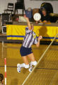 Kelly Kaylor jumps to spike the volleyball, 1998