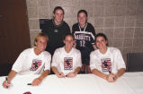Maureen Bothwell and Kelly (Roethe) Hodges with members of the U.S. women's national soccer team,...