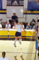 Katherine Lindros Ivey jumps to spike the volleyball, 1999