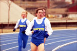 Amy Ericson Klein leads Marquette runners in outdoor race, 1996
