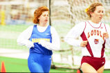 Kristen McCotter runs against Loyola athlete in outdoor race, 1996