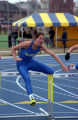 Joy (Krekelberg) Bauman jumps hurdle, 1996