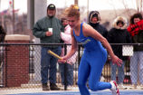Unidentified track athlete runs outdoor race, 1996