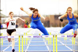 Joy (Krekelberg) Bauman and Jeannie Kauth Rosner jump hurdles, 1996