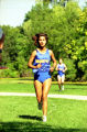Alexandra Maldonado runs outdoor race, 1995
