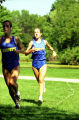 Jennifer Koenigsmark-Frank and unidentified athlete run outdoor race, 1995