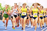 Sarah McCullough and Erika (Jacobsen) Miller lead pack in outdoor race, 1999