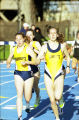 Megan Plante, Sandy Fondow, and Jodi Bolen run outdoor race, 2000