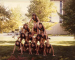 Women's cross-country team in a human pyramid, 1979