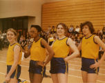 Relay team posing at an indoor meet, 1979