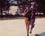 Krista (Tills) Cabrera and Irene (Tarach) Lewis running on track, 1980